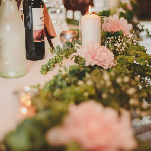 Table floral runner. Romantic candles and wine. Sea Tree Weddings.