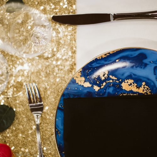 Gold, and blue wedding place setting. Sea Tree Weddings.