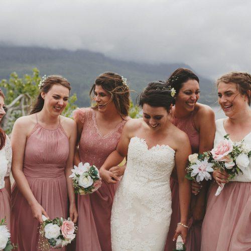 Smiling bridesmaids with bride. Sea Tree Weddings.